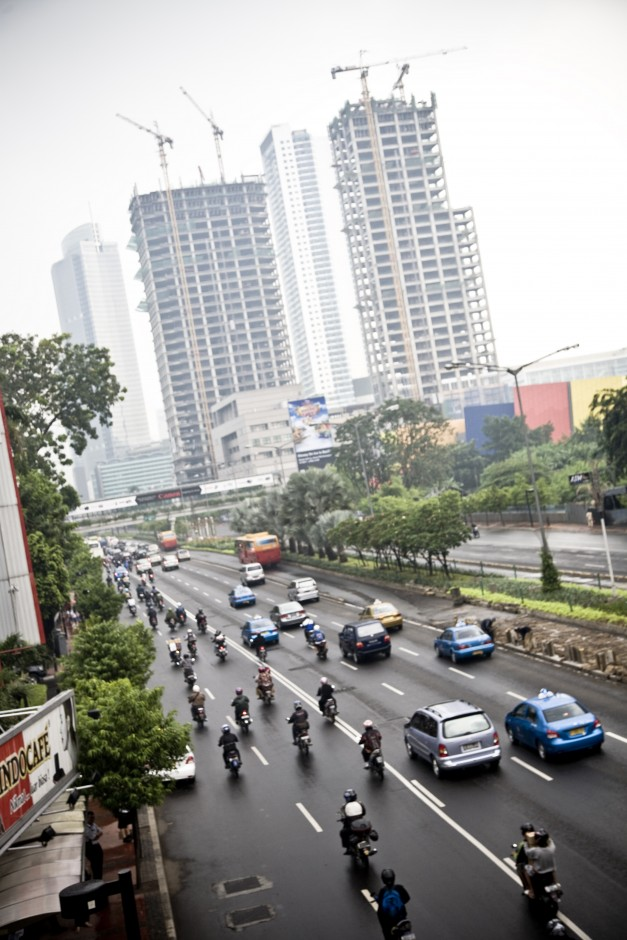 Traffic makes it's way through an expressway on a wet day in Jakarta.