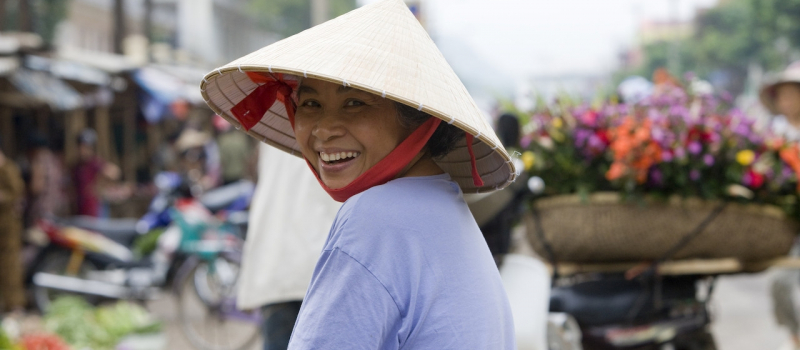 Son La, Vietnam – An middle-aged Black Thai woman visits the weekly market.