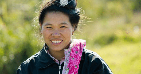 woman from east asia in traditional dress smiles beautifully omf devotional we are not consumed